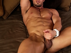 Spreading his convention across the bed he jerks off till such time as he reaches delight