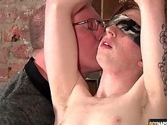 Blindfolded and ricochet boy stroked by his old hand