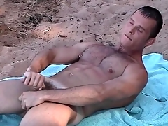 Pock-marked nipple gay guy jerks off on a difficulty seashore