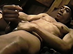 Muscled black pencil massages his big balls together with strokes his huge tire