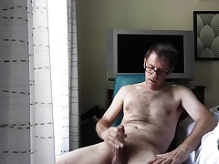 Wank with the addition of Cumshot in hotel room hard by window